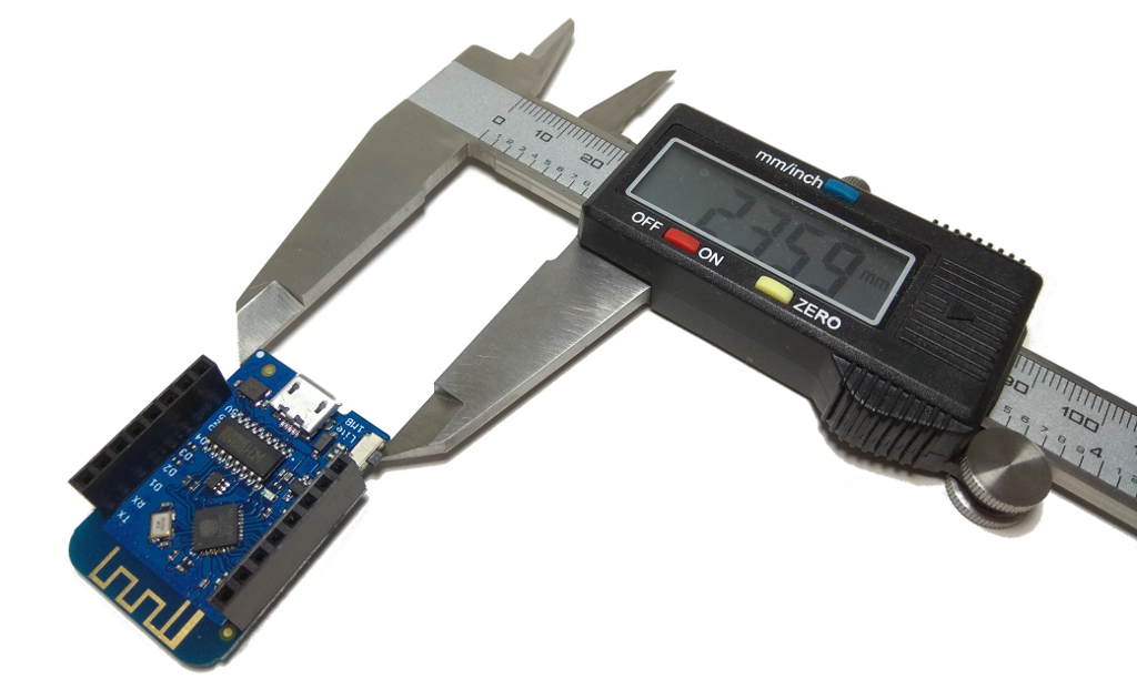 Calipers measuring Wemos board